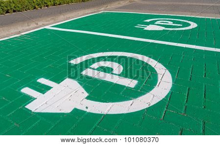 parking place with charging symbol for electric cars