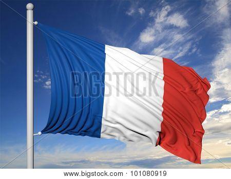 Waving flag of France on flagpole, on blue sky background.