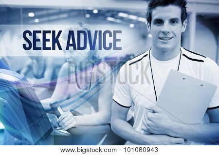 The word seek advice against spinning class instructor holding clipboard