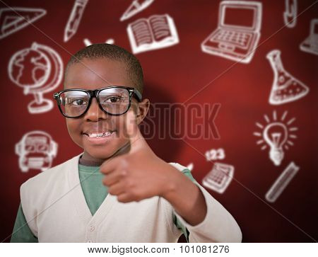 Cute pupil with thumbs up against desk