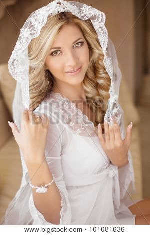 Beautiful Smiling Bride In Bridal Veil And Wedding Dress. Beauty Portrait. Happy Girl In Wedding Day