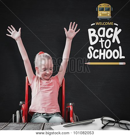 Cute disabled pupil smiling in hall against blackboard