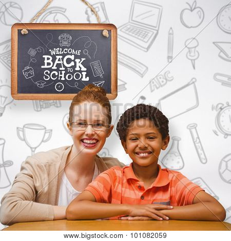 Happy pupil and teacher against grey background