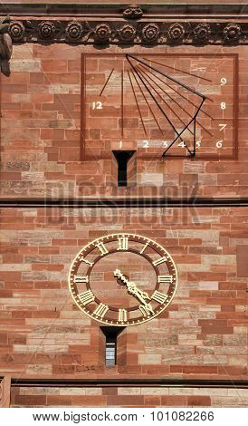 Sundial and clock on Basel Cathedral, Switzerland