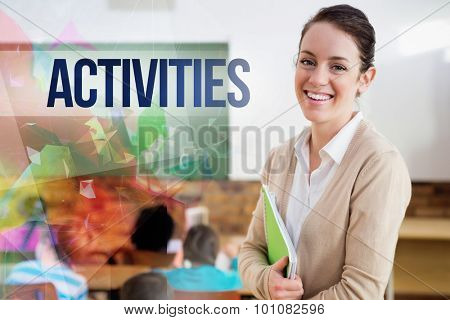 The word activities against pretty teacher smiling at camera at back of classroom