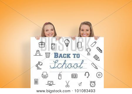 Close up of young women behind a blank sign against orange vignette