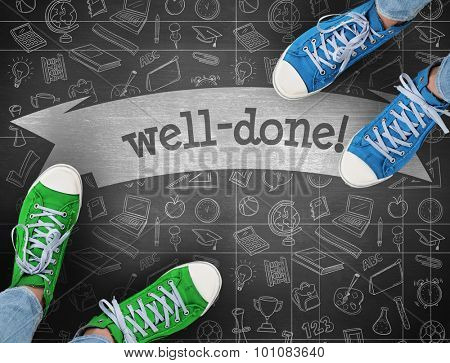 The word well-done! and casual shoes against black background