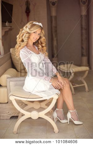Beautiful Happy Smiling Bride Girl With Healthy Curly Hair Wearing In White Wedding Gown Sitting On