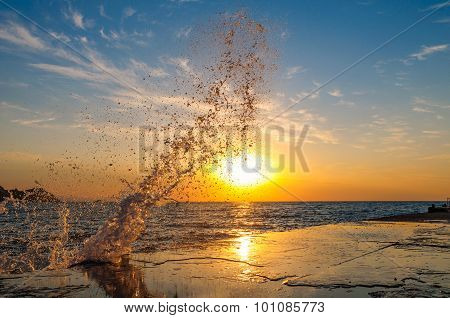 Splash in the sea at dawn