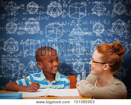 Happy pupil and teacher against blue chalkboard