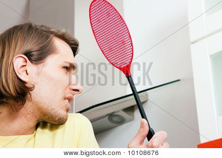 Man with a fly swat
