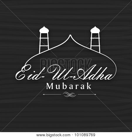 Creative mosque with text Eid-Ul-Adha Mubarak on grey background for muslim community festival of sacrifice celebration.