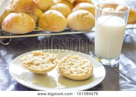Baked Bread And Buns And A Glass Of Milk