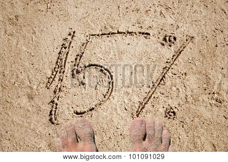 Conceptual 5% handwritten in sand for natural, symbol, tourism or conceptual designs with feet