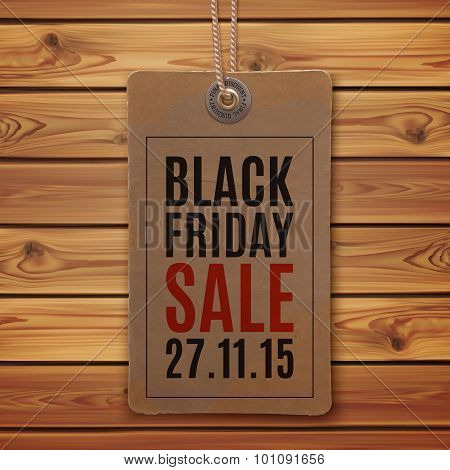 Black Friday sale. Price tag on wooden planks.