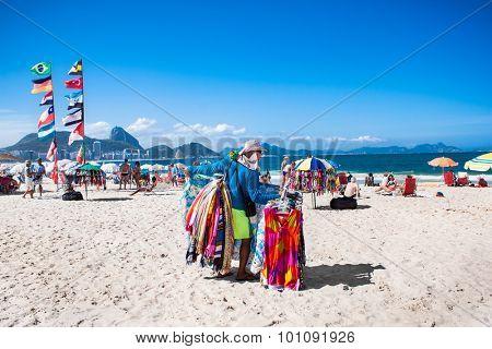 RIO DE JANEIRO, BRAZIL - APRIL 24, 2015: Brazilian street vendor sells table cloths on April 24, 2015 at Copacabana Beach, Rio de Janeiro. Brazil.