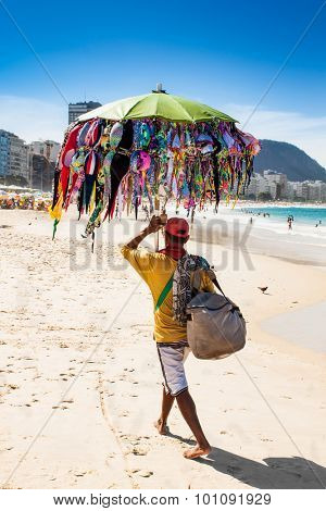 RIO DE JANEIRO, BRAZIL - APRIL 24, 2015: Brazilian street vendor sells swimsuit on April 24, 2015 at Copacabana Beach, Rio de Janeiro. Brazil.