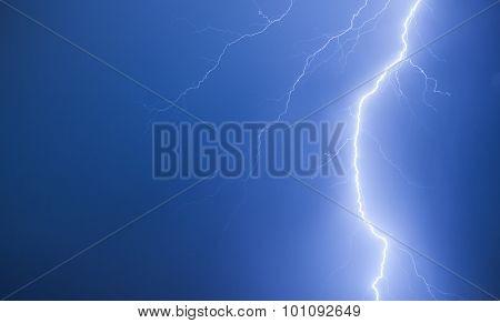 Bright Lightning On A Dark Blue Night Sky