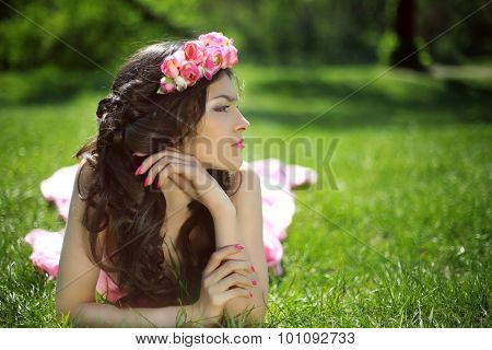 Beauty Romantic Girl Outdoors. Beautiful Teenage Model Girl With Flower Chaplet Lying On The Green G