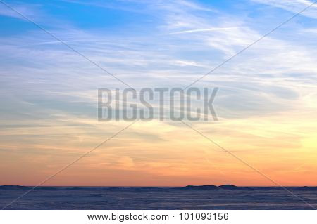 Bright colorful sky over the snowy desert