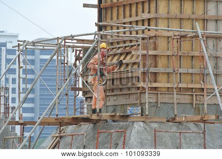 A construction worker fabricating column formwork