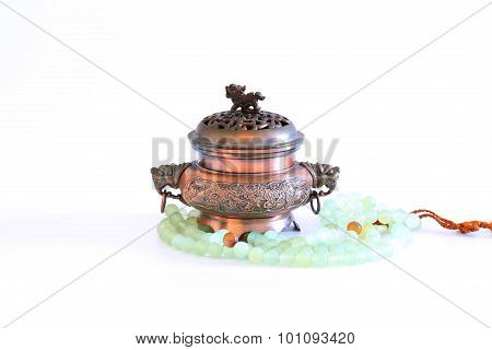 Incense Burner and Buddha Beads on White Background