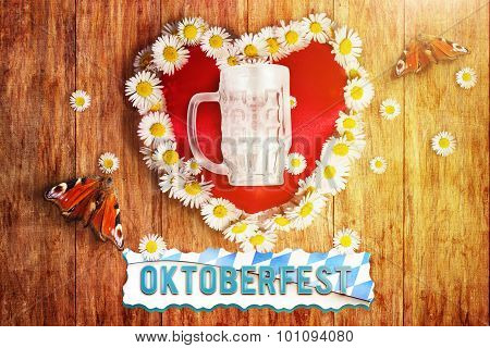 Greeting Card Of Bavarian Oktoberfest With Heart And Marguerites And Butterflies On Wooden Board