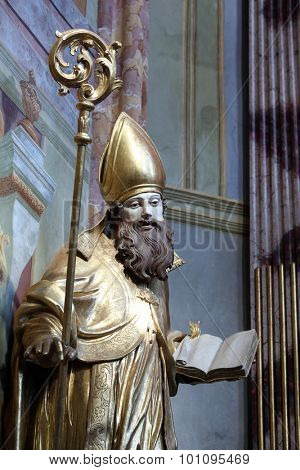 LEPOGLAVA, CROATIA - SEPTEMBER 21: Saint Ambrose on the main altar of Holy Cross, parish Church of the Immaculate Conception of the Virgin Mary in Lepoglava, Croatia on September 21, 2014
