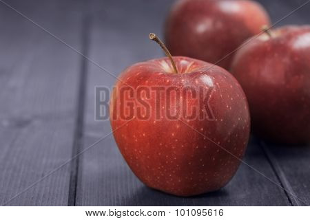 Red Apples On A Dark Blue Background