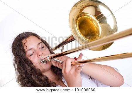 Teenage girl playing the trombone