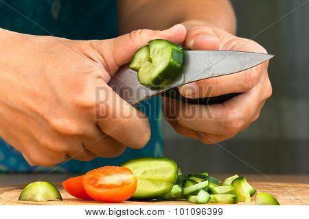 Hands Chopping Cucumber For Salad, Closeup
