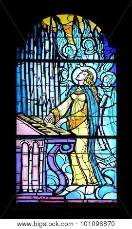PAKRAC, CROATIA - MAY 07: Saint Cecilia, stained glass window in the Church of the Assumption of the Blessed Virgin Mary in Pakrac, Croatia on May 07, 2015