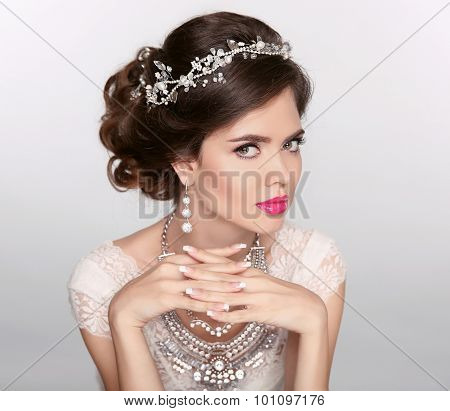 Beautiful Elegant Girl Model With Jewelry, Makeup And Retro Hair Styling. Manicured Nails. Isolated