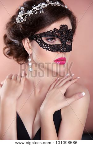 Beauty Fashion Girl Model With Mask. Makeup. Hairstyle. Jewelry. Sensual Woman Wearing Venetian Masq