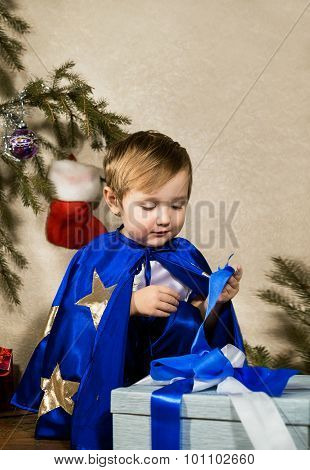 Child In The New Year Costume Opening Christmas Gift