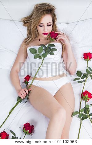 Sexy woman in corset with roses