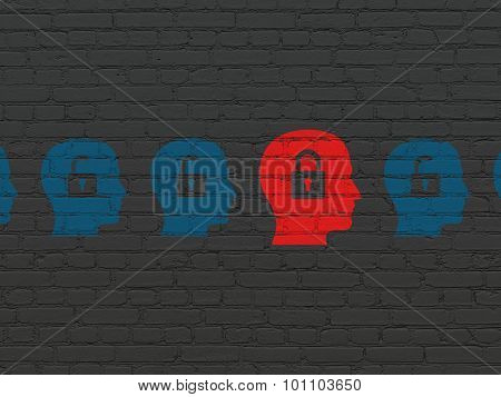 Finance concept: head with padlock icon on wall background