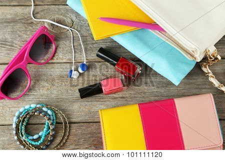 Women's Accessories On A Grey Wooden Background