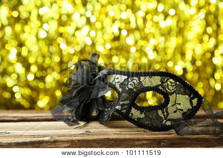 Female Carnival Mask With Bokeh On Brown Wooden Background