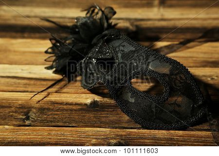 Female Carnival Mask On Brown Wooden Background