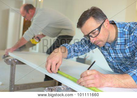 Measuring plank of wood