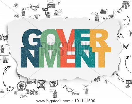 Political concept: Government on Torn Paper background