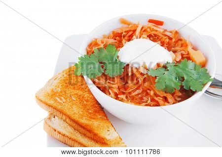 red soup with sour cream and bread