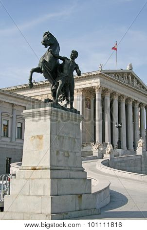 Bronze Horse Tamer In Front Of Austrian Parliament Building In Vienna, Austria