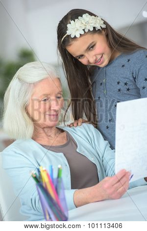 Little girl drawing a picture for grandma