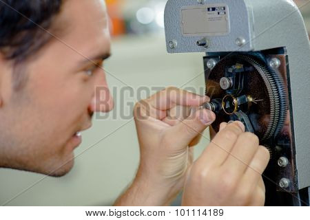 Jeweller making adjustments to a ring