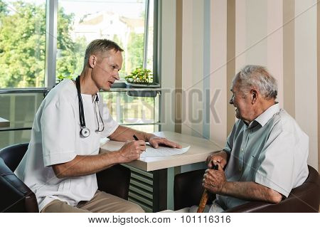 Healthcare Worker And Elderly Patient