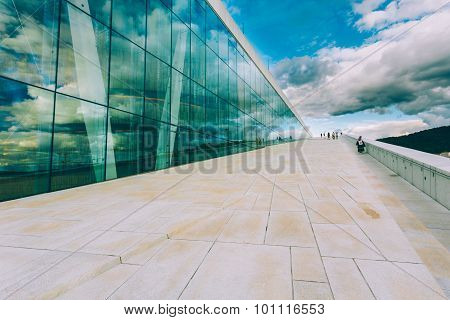 People walking on roof of The Oslo Opera House, Norway. The Osl