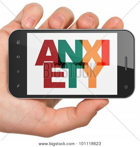 Medicine concept: Hand Holding Smartphone with Anxiety on  display