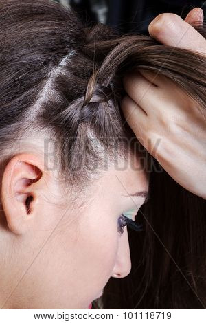 weaving braids girl in a hairdressing salon